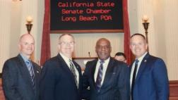 Senators Bradford takes a picture on the Senate Floor with leadership from the Long Beach Police Officers Association.